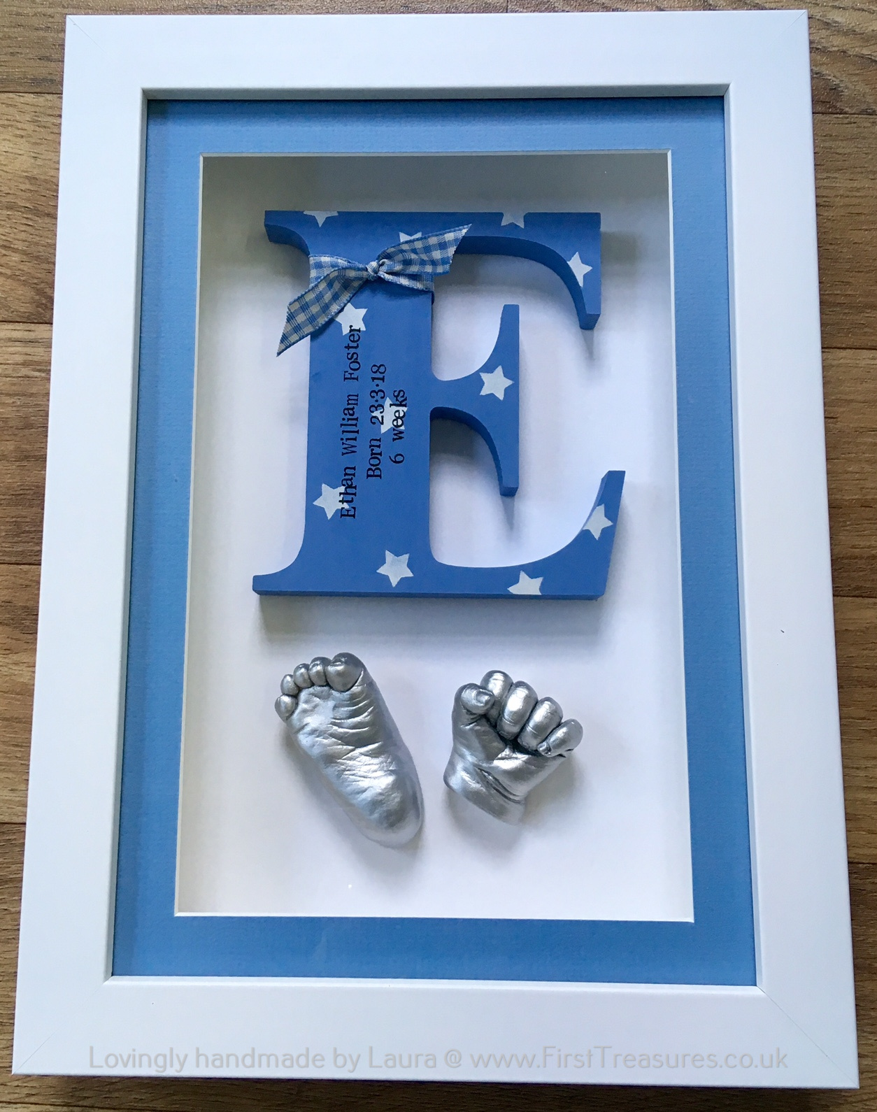 3d framed hand and foot casts with wooden initial
