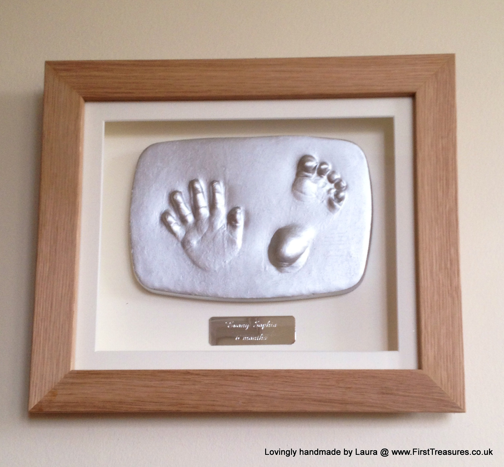 Framed hand and foot outprint